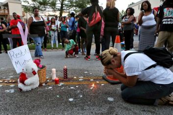 Mourners at the site of the shooting.