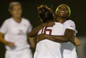 Teammates celebrate Cheyna Williams 1st of 2 goals on the night.
