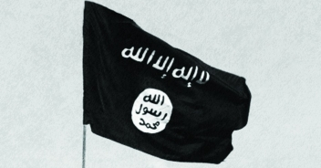"The ISIS flag, which translates to ""There Is No God But God' and ""God Messenger Mohammed."""