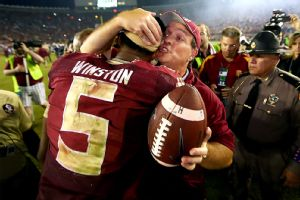 Coach Fisher embraces Winston after game. Photo from ESPN.com